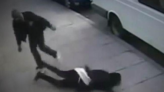 Another victim of the so-called 'knockout' game falls to the ground following an attack.