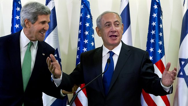 Standing next to US Secretary of State John Kerry in Jerusalem, Israeli Prime Minister Benjamin Netanyahu stressed his belief that the Geneva agreement would have deep repercussions for Iran, Syria's close ally. Picture: Jim Hollander