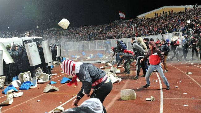 Russian riot policemen protect themselves with their shields as football fans clash during the Russia's premier league football match Shinnik Yroslavl vs. Spartak Moscow in Yaroslavl on October 30. Picture: AFP PHOTO