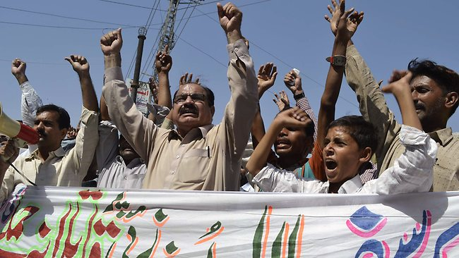Pakistani activists shout slogans during a protest against an assassination attempt on Malala Yousafzai, in Multan on October 10, 2012. Pakistani doctors removed a bullet from a 14-year-old child campaigner shot by the Taliban in a horrific attack condemned by national leaders and rights activists. The attack took place in Mingora, the main town of the Swat valley in Pakistan's northwest, where Malala had campaigned for the right to an education during a two-year Taliban insurgency which the army said it had crushed in 2009. AFP PHOTO / S.S MIRZA