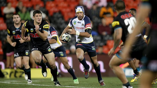 Johnathan Thurston makes a break for the Cowboys. Picture: Gregg Porteous