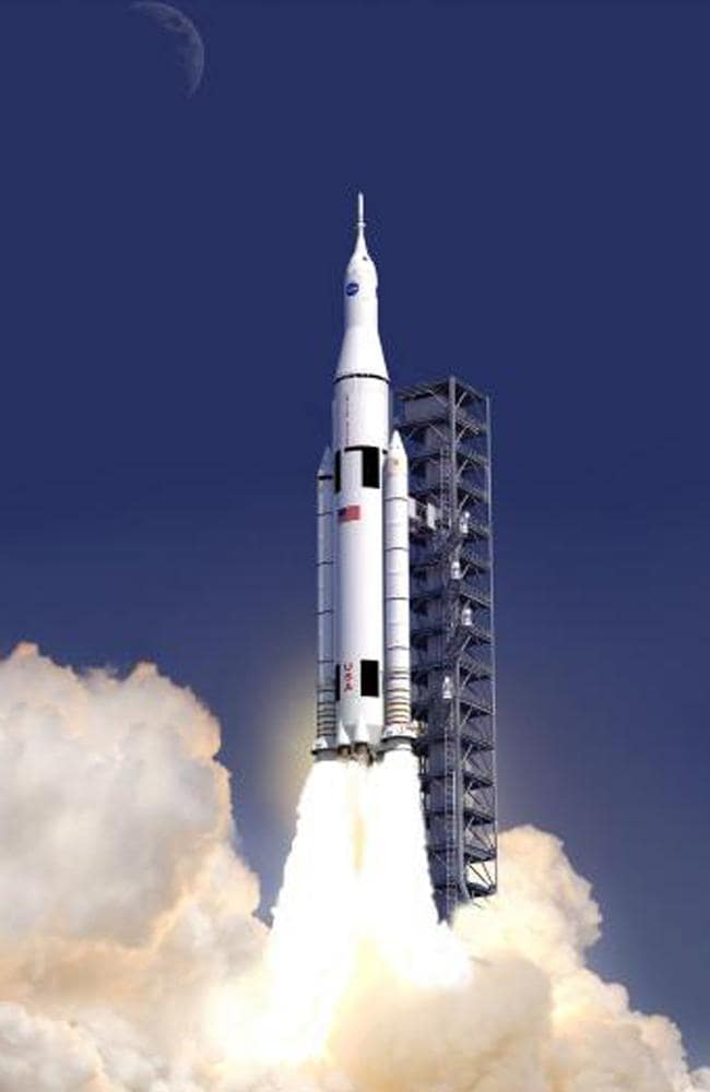 An artist concept provided by NASA shows the launch of the Space Launch System. AP Photo/NASA
