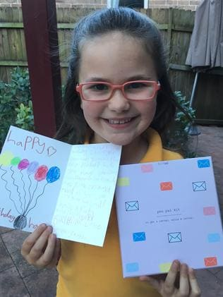 Hannah Gee enjoys writing to her pen pal. Picture: Supplied