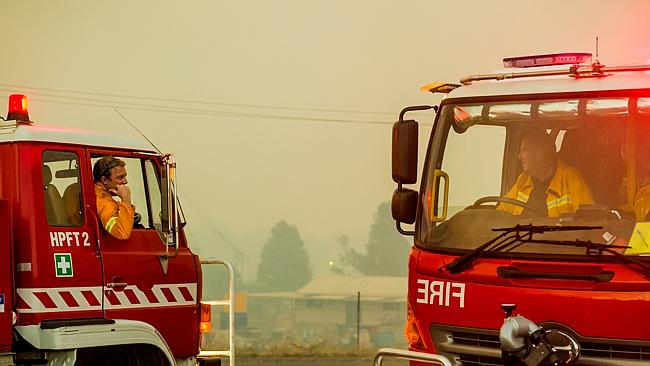 Firefighters discuss tactics during their fight in Morwell. Picture: Jason Edwards.