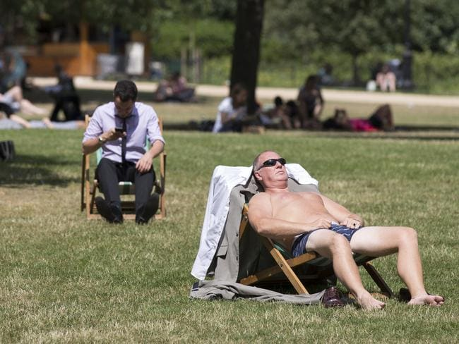 Steaming ... A man enjoys the warm weather in St. James's Park today. Photo: Oli Scarff