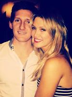 Singer Delta Goodrem cuddles up to her brother Trent at his engagement party. Picture: Instagram