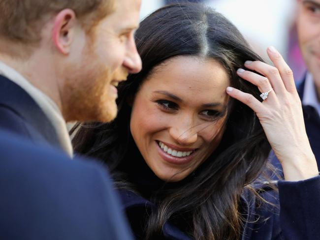 Prince Harry and Meghan Markle smiled and chatted with well wishers who waved flags and handed them flowers. Picture: Christopher Furlong/Getty Images.