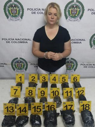 """This April 12, 2017 photo released by Colombia's National Police press shows Australian Cassandra Sainsbury in handcuffs after she was arrested at the international airport in Bogota, Colombia,"" writes AP via Colombia's National Police."
