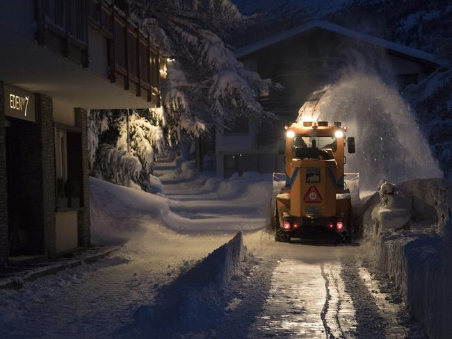 A snow plough clears snow in Saas Fee, which is about 18km north east of Zermatt, Switzerland. Picture: AP