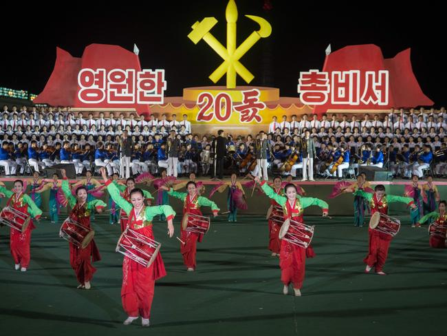 Participants described as 'working people, youth, and students of Pyongyang' perform during a mass gala event marking the 20th anniversary of late North Korean leader Kim Jong Il's election as general secretary of the Workers' Party of Korea (WPK). Picture: AFP / KIM Won-Jin