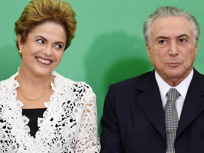 Brazilian President Dilma Rousseff (L) and her vice-president Michel Temer in happier times. Picture: AFP