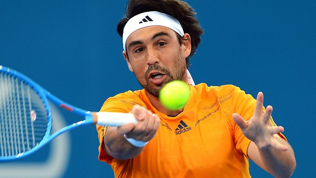 Marcos Baghdatis of Cyprus hits a forehand return to Gilles Simon of France in their quarter-final match at the Brisbane International. Picture: William West