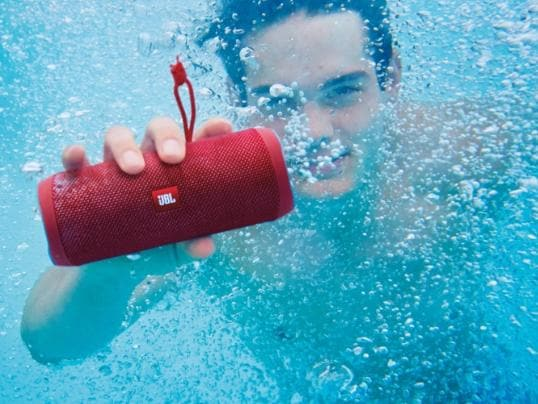 The JBL Flip 4 is a wireless speaker with a water-resistant exterior.