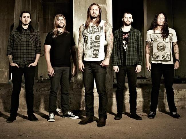 As I Lay Dying ... Lambesis, centre, with his band mates. Many Christian rockers are atheists who are faking their faith in God to sell records in the lucrative Christian market, Lambesis claims. Picture: Facebook