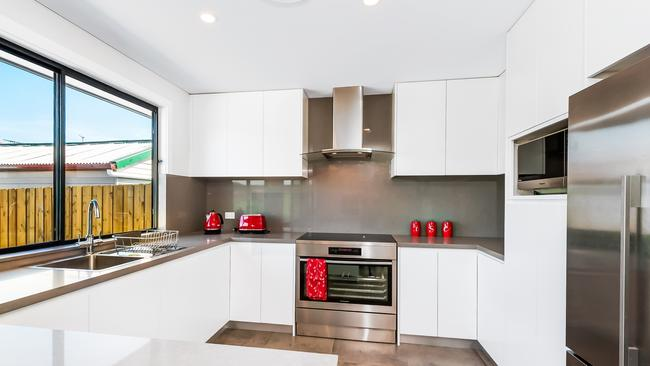 This granny flat has a luxurious kitchen with modern appliances