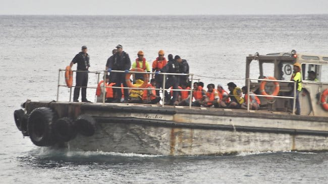 A barge carrying survivors of the boat tragedy nears Christmas Island. Picture: Getty Images