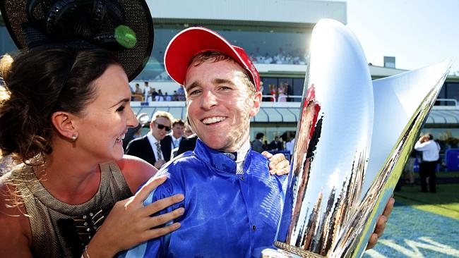 Jockey Nathan Berry rides no1 Unencumbered to the win in the Magic Millions 2YO Classic on the Gold Coast and is hugged fiance Whitney Schofield. Pics Adam Head