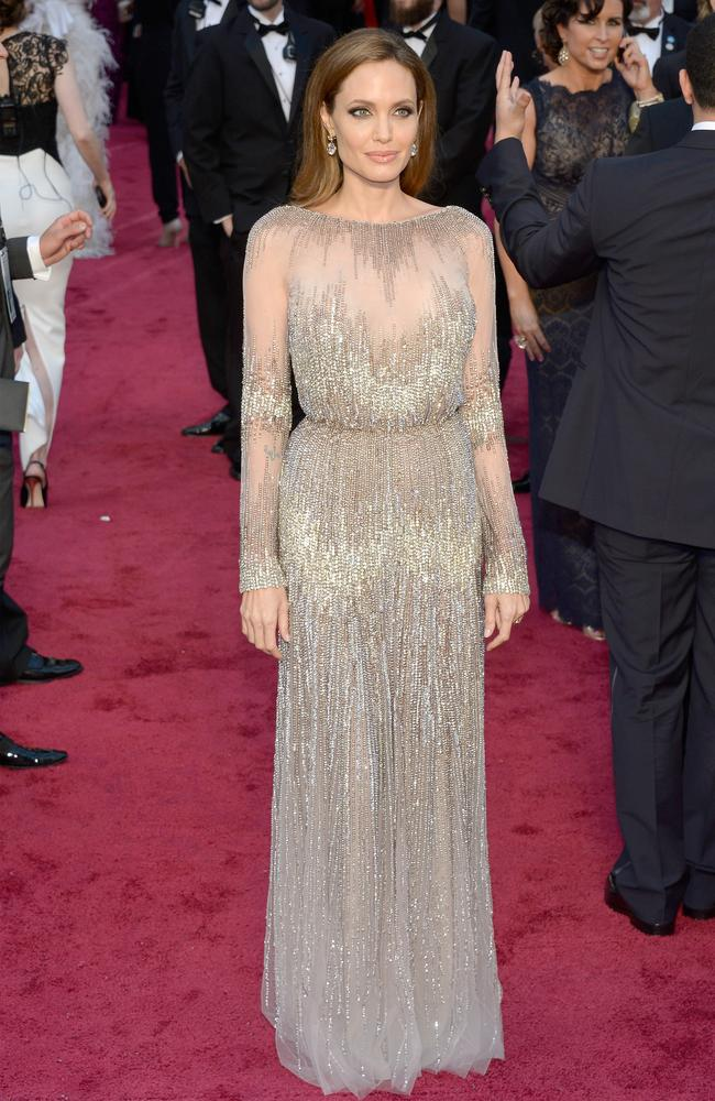 Angelina Jolie's Elie Saab was universally loved by the critics. The sheer sparkly gown draped beautifully and was teamed with simple loose locks. Picture: Getty
