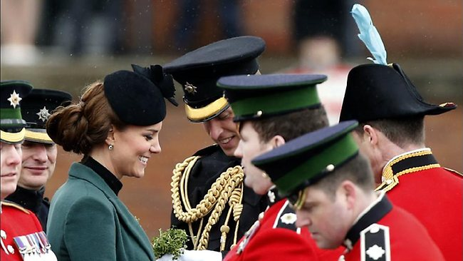 Photo Date: 18/03/2013 00:29 Reference: N22576645 Britain's Kate Duchess of Cambridge, third left, stands with her husband Prince William, fourth left, before presenting traditional sprigs of shamrock to members of the 1st Battalion Irish Guards at the St Patricks Day Parade at Mons Barracks in Aldershot, England, Sunday, March 17, 2013. Kate presenting the sprigs of shamrocks to the regiment Sunday, follows a century-old tradition inaugurated by Queen Alexandra, the wife of the then King, Edward VII back in 1901. (AP Photo/Matt Dunham)