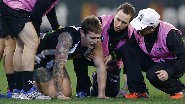 Dayne Beams in pain after injuries his leg. Picture: Michael Klein