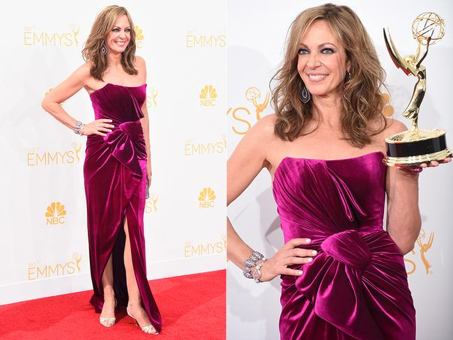 Allison Janney celebrates her win at the 2014 Primetime Emmy Awards red carpet. Picture: Getty/AFP