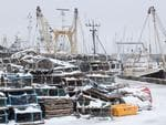Snow covers lobster pots at the port in the sea side resort of Scarborough in North Yorkshire on February 27, 2018. A blast of Siberian weather sent temperatures plunging across much of Europe on Tuesday, causing headaches for travellers and leading to several deaths from exposure as snow carpeted palm-lined Mediterranean beaches. Picture: AFP