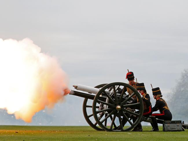 Members of the Kings Troop Royal Horse Artillery fire a First World War era field gun in a 41-roundsalute to mark the birth of the prince. Picture: AFP Photo / Adrian Dennis