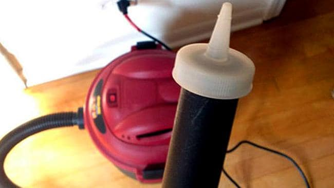 A ketchup lid will help vacuum up dust resting in hard to reach places. Picture: Lifehacker.com