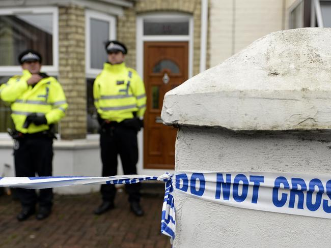 Raid ... Police officers outside a house in Desborough Avenue, High Wycombe after four men were arrested in connection with an alleged Islamist terror plot. Photo: Andrew Matthews/PA Wire