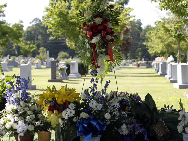 Final resting place ... Flowers cover the grave of Cooper Harris at the Tuscaloosa Memorial Park Cemetery. Pic: AP Photo/Butch Dill