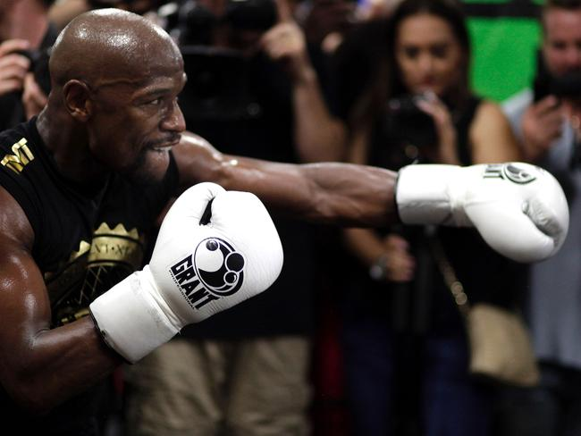 Boxer Floyd Mayweather Jr. pummels the speed bag.