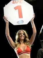 BRISBANE, AUSTRALIA - DECEMBER 07: Ring girl Kahili Blundell displays the first round card at the UFC Fight Night Brisbane at the Brisbane Entertainment Centre on December 7, 2013 in Brisbane, Australia. (Photo by Bradley Kanaris/Getty Images)