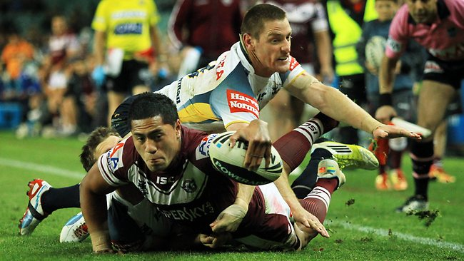 Jorge Taufua scores for Manly during the NRL elimination final against the Cowboys. Picture: Mark Evans
