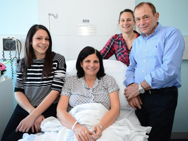 Surviving surgery ... Silvana Mazzacura, recovers after a brain tumour was removed by AMA president Brian Owler, with her family, husband Domenic and daughters Christina and Josie. Picture: Jeremy Piper