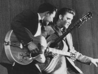 Guitarist Scotty Moore with singer Elvis Presley in 1956.