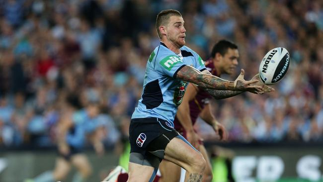 Blues star Josh Dugan catches the ball.