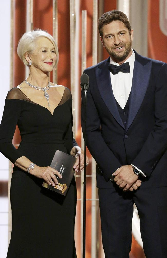 Presenters Helen Mirren and Gerard Butler speak onstage during the 73rd Annual Golden Globe Awards at The Beverly Hilton Hotel on January 10, 2016 in Beverly Hills, California. (Photo by Paul Drinkwater/NBCUniversal via Getty Images)