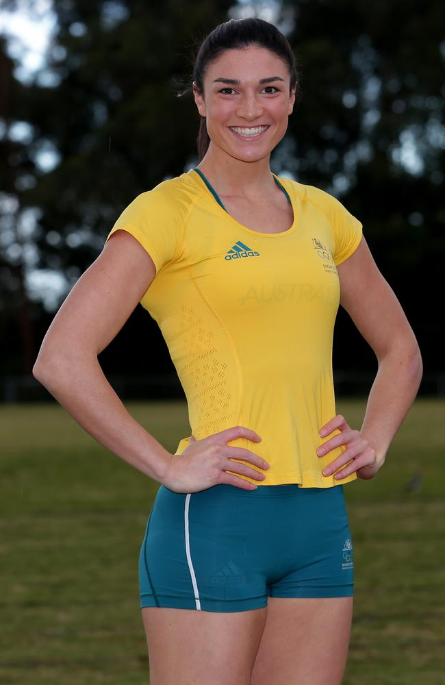 Michelle Jenneke proudly shows off her Australian Commonwealth Games uniform.