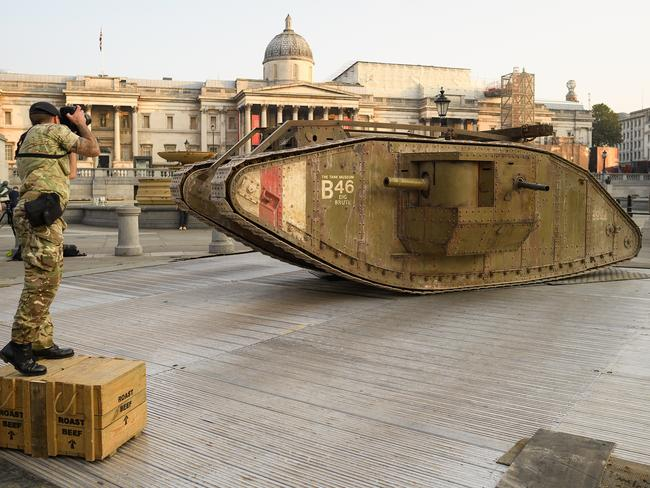An Army photographer takes a photograph of a replica British Mark IV tank as it is displayed in Trafalgar Square in London last month. Picture: Leon Neal/Getty Images