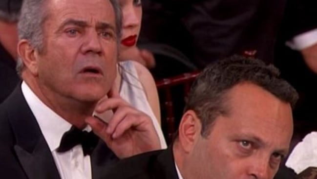 Gibson and Vince Vaughn glare daggers through Meryl Streep's Golden Globes anti-Trump speech. Picture: NBC.