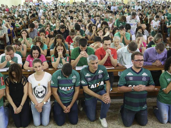 Supporters of Brazil's soccer team Chapecoense attend Mass at the city's Cathedral in Chapeco.
