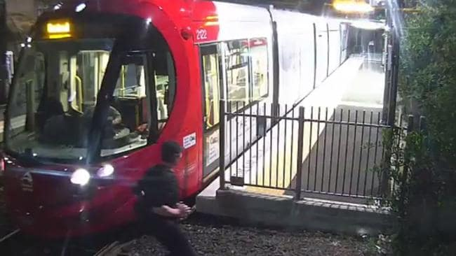 A man has a very narrow escape from a tram at Dulwich Grove, Sydney. Source: News Corp Australia