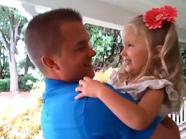 She is so happy to have her dad home and in her arms.