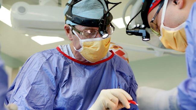 Dr Anthony Lynham and Dr George Chu perform eye socket surgery on an assault victim. Picture: Mark Calleja