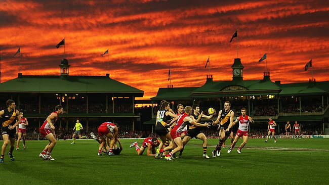 Sunset during second quarter of AFL match between Sydney Swans v Richmond Tigers at the SCG. Picture: Hillyard Philip