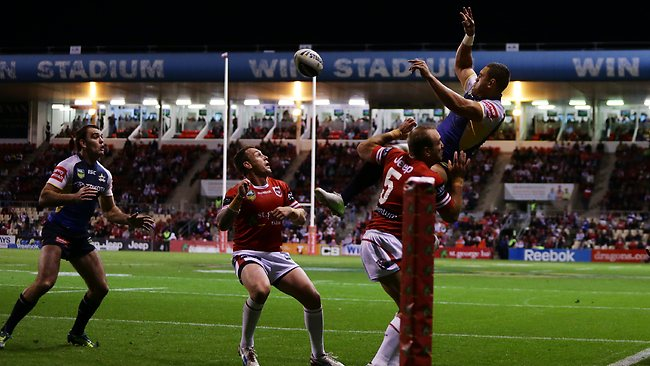 North Queenland's Antonio Winterstein keeps a ball in play for Kane Linnett to score a try during the St George Dragons v North Queensland round 14 NRL game at WIN Stadium. Picture: Costello Brett