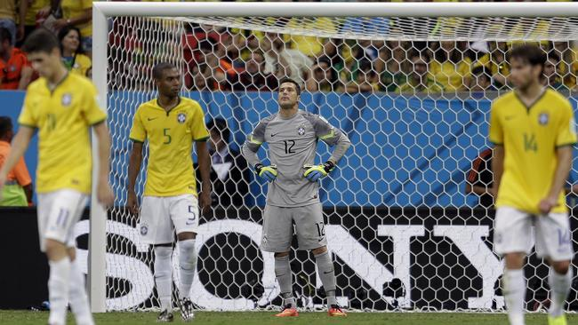 Brazil's goalkeeper Julio Cesar rues another goal.