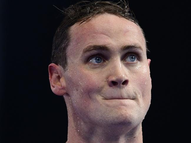 Australia's Mack Horton reacts after competing in a men's 400m freestyle heat during the swimming competition at the 2017 FINA World Championships in Budapest, on July 23, 2017.  / AFP PHOTO / Martin BUREAU