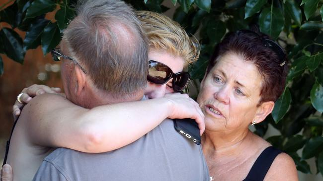 Relatives and friends at the scene. Picture: Richard Gosling