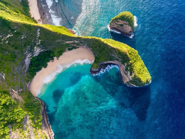 ESCAPE: Cover Story, Bali Beaches, John Borthwick -  Tropical beach and cliff on the island of Nusa Penida, Indonesia  Picture: Istock
